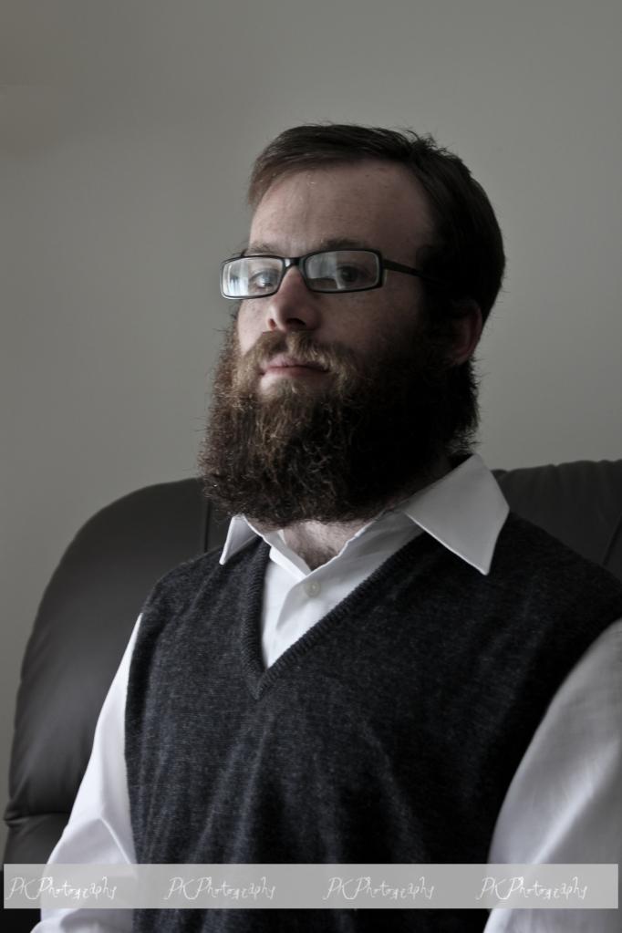 Proud posture  and displaying his beard.