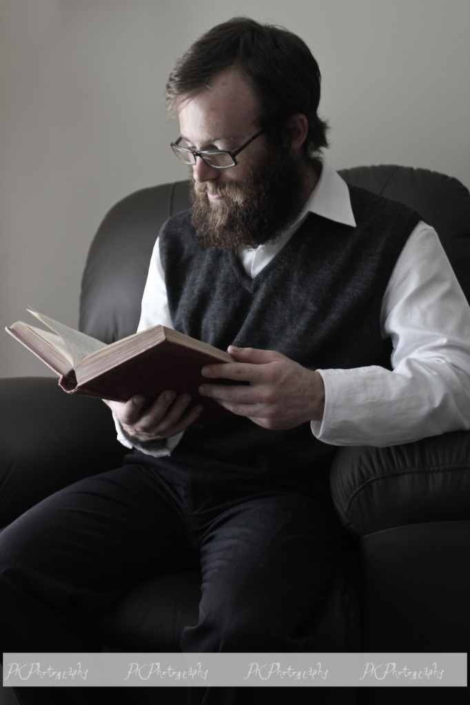 A book was a common prop in portraits of that era.